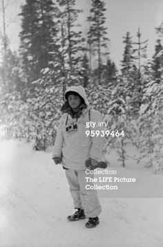 Full-length portrait of American photographer Carl Mydans (1907 - 2004) as he stands in the snow and covers the Winter War between Finland and the Soviet Union, Finland, 1940. (Photo by Carl Mydans/Time & Life Pictures/Getty Images)