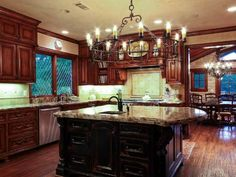 Awesome circle chandelier, not to mentions the kitchen is fabulous!!!