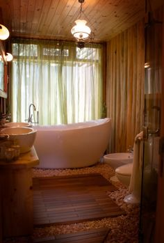 Ummm, looks cool but I don't know how clean that floor full of rocks would be after a while especially around the toilet! Yuck!