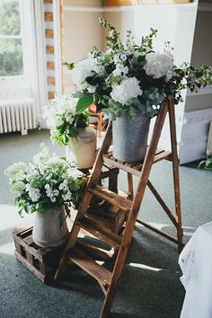 Lovely white wedding flowers in jugs on a vintage/old fashioned wooden step ladder. From 'A Low Key, Intimate, Family Lunch Style Wedding By The Sea, With Just 10 Guests'. Photography http://www.daleweeksphotography.co.uk/