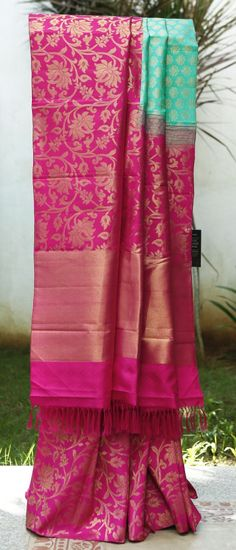 A grand Kanchivaram in a striking pink and blue combination. This half and half saree has a beautiful zari weave all over the body and pallu Phulkari Saree, Kanjivaram Sarees, Kanchipuram Saree, Indian Silk Sarees, Indian Beauty Saree, Indian Attire, Indian Wear, Indian Dresses, Indian Outfits