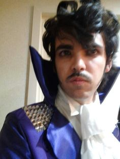 Prince costume,  cosplay.  His purpleness, purple rain,  when doves cry, darling Nikki