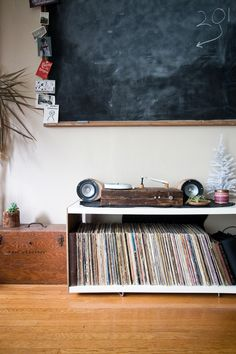 wooden turntable and a classroom chalkboard.