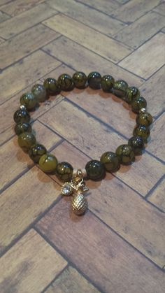 Agate Bead and Pineapple charm Stretch Bracelet, in my Etsy shop https://www.etsy.com/listing/265688075/translucent-agate-and-pineapple-charm