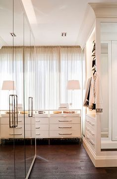 Love the mirrored wardrobes here.
