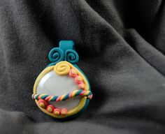 Teal, yellow and pink pendant - Whirligig