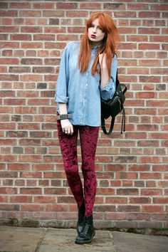 red velvet leggings. denim. chambray shirt. black leather shoes and bag. redhead