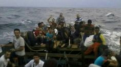 A group of 20 asylum seekers has been found stranded on a tiny Indonesian island and claim they were turned back at the border by Australian warships.