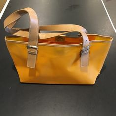 Nine West bag Orange Nine West bag. There a a few small marks on the bag but nothing very noticeable Nine West Bags
