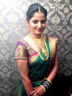 Traditional Southern Indian bride wearing bridal silk saree and jewellery. Reception look. Makeup and hairstyle by Swank Studio. #BridalSareeBlouse #SariBlouseDesign  Silk kanchipuram sari. Braid with fresh flowers. Tamil bride. Telugu bride. Kannada bride. Hindu bride. Malayalee bride  Find us at https://www.facebook.com/SwankStudioBangalore