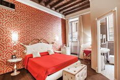 Bold colors & patterns make this bedroom in Rome, Italy come to life.