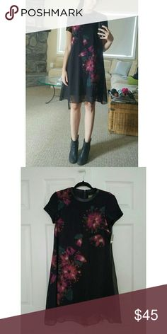 Black floral dress Knee length black chiffon dress with attached slip and faux leather trim on neck and zipper back. Dresses Midi