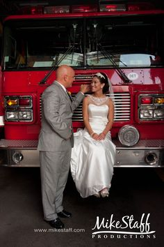 bride and groom with the fire engine #firetruck wedding #wedding photo ideas