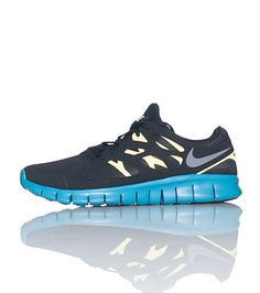 NIKE Low top women's running sneaker Lace up closure Mesh throughout Flexible material for ultimate comfort Cushioned sole Blue and yellow accents. AHHH BLUE!!! (:
