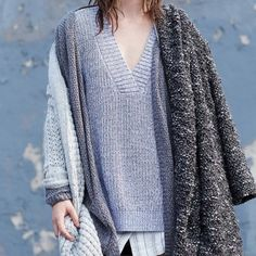 Urban Outfitters silence and noise knit sweater New and never worn but no tags.  Grey knit sweater. XS. Super soft and cozy. A bit oversized with slits in the side. Urban Outfitters Tops