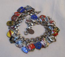 Vintage European enamel & silver travel 28 charm bracelet from Green Mannequin on Ruby Lane