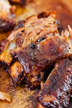 These tender honey butter ribs are oven baked to perfection and they fall off the bone! They are literally bathed in honey butter and brown sugar. - May 11 2019 at Oven Baked Pork Ribs, Ribs Recipe Oven, Pork Loin Ribs, Bbq Ribs, Oven Baked Beef Ribs, Oven Roasted Ribs, Pork Ribs Grilled, Baked Ham, Slow Cooking