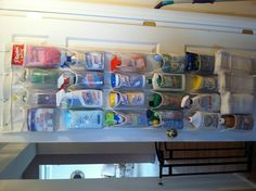 I hated keeping all my cleaning products under the sink so I organized them on the back of the basement door