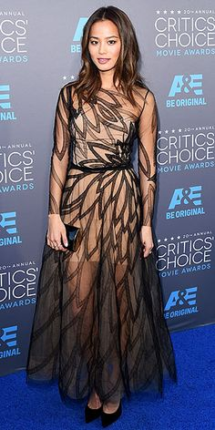 Must-See Looks from the Critics' Choice Awards | JAMIE CHUNG | We love how Jamie's black clutch and pumps make the petal-like print of her Yanina Couture dress pop. Bonus points for keeping her makeup nude to match the underlay of her ensemble.