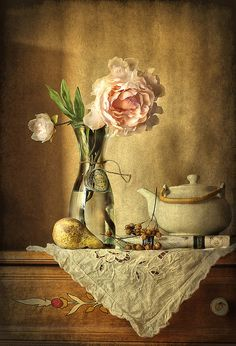 still life with rose, a pear, teapot on the painted chest...