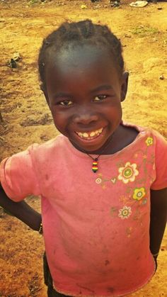 Kissidougou, Guinea 2014- that time when I met this happy girl by my dad's house. She has such a beautiful smile...she said she's a future doctor.