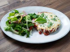 """Chicken Patty Parm with Salami Salad (Roasted Chicken Patty Parm and Salami Salad) - Rachael Ray, Meals"""" on the Food Network. Food Network Recipes, Cooking Recipes, Chicken Patties, Oven Roasted Chicken, Ground Chicken, Ground Meat, Ground Turkey, Pasta, 30 Minute Meals"""