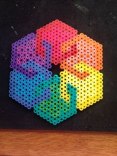 Rainbow geometric design perler beads by Katie Binesh Melty Bead Patterns, Pearler Bead Patterns, Perler Patterns, Beading Patterns, Geometric Patterns, Hama Beads, Perler Bead Art, Fuse Beads, Pony Bead Projects