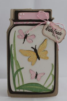To complete: pink paper, tan paper, white paper, green paper, pink twine, butterfly sticker
