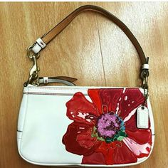 COACH POPPY FLOWER WRISTLET-LIMITED EDITION Authentic-White Leather with Tapestry Poppy Flower,  beautiful maroon inside lining. Measures 5 x 8 x 1.75.  Excellent condition with one small pen mark on lower right corner on back side-3rd picture-, hardly noticeable.  **RARE ITEM Coach Bags Clutches & Wristlets