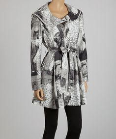 Blustery sidewalks are transformed into chic catwalks when this trench is on display. An eye-catching newspaper print and flattering belted waist finish the look of this fashionable number.