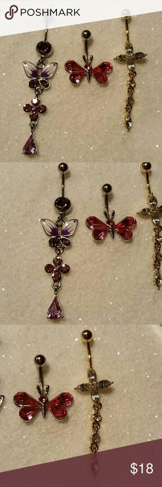 """3 NEW Butterfly & Flower Crystal Dangle Navel Ring SET OF THREE New, never used (as that is unsanitary, even when well cleaned) navel (belly button) body piercing jewelry. Surgical steel, standard 14g 1/2"""" length curved / banana barbell, one gold titanium plated clear crystal rhinestone flower & 1"""" dangle charm, one pink crystal butterfly, and one purple and white enameled butterfly with a 1.75"""" purple crystal dangle.  More new body jewelry available in my closet!  Thank you for visiting…"""