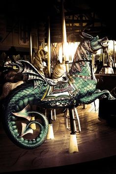 Carousel hippocampus seahorse fantasy creature with lovely green scales.