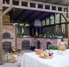 Outdoor kitchen with smoker, grill, and oven combo