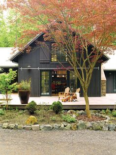 I LOVE the pole barn look with wide A frame roof. Big window with shutters like a Hay loft! French rolling doors on the bottom floor. & This dragon breath black color! John Squared : calla woods farmhouse