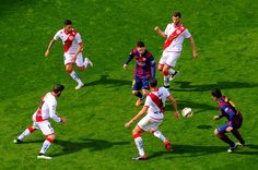 Lionel Messi of FC Barcelona competes for the ball among Rayo Vallecano de Madrid players during the La Liga match between FC Barcelona and Rayo Vallecano de Madrid at Camp Nou on March 8, 2015 in Barcelona, Catalonia.