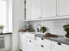 Kitchen - white brick and concrete