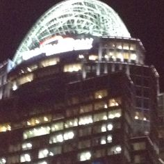 The Great American Tower at Queen City Square in Cincinnati. She wears a tiara.