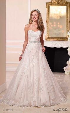 Make it a magical day in this satin A-line princess wedding dress from the Stella York bridal gown collection. It features hand-placed lace on its fitted bodice, full skirt, and chapel train. Wear this gorgeous dress with its 1.5″ Diamante-encrusted grosgrain waist belt for added elegance.