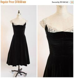 Vintage 1950s party dress by Emma Domb. Made of black velvet. Cream mesh tulle with floral lace embroidery adorns sweetheart neckline and cap