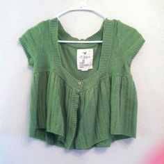Bright green sweater Bright green short sleeved sweater with 2 button closure. Crop length,  gently worn, but still so cute! Cavalini Sweaters Cardigans