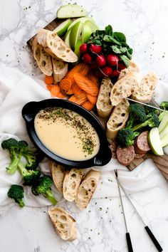 Classic Cheese Fondue without the alcohol. Double cheddar with a kick. Dip with apples, bread, veggies or pretzels. Perfect for a night in | Oh So Delicioso