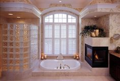 bathroom with fireplace next to tub