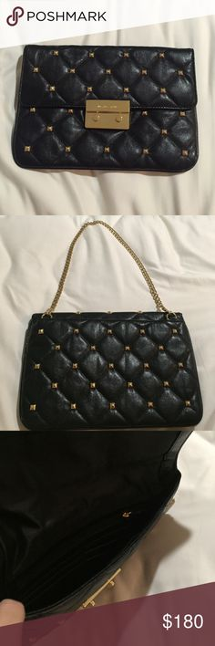 Michael Kors stud clutch Black and gold stud clutch. This has a short gold chain with a back pocket. Inside there are 6 card slots, a zipper pocket and another small pocket. The studs give it a quilted look. Michael Kors Bags Clutches & Wristlets