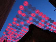 illuminated umbrella installation in a Vancouver Chinatown alley
