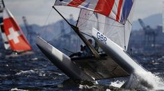 """Mason describes the image of Scott's elation as """"one the nicest, cleanest"""" he's ever taken -- telling CNN Sport  the ultimate aim is always """"a picture that tells a story with a key moment, key athlete and beautiful light.""""  But sometimes it's about pure action. Here, a member of the Nacra 17 Olympic fleet fights with testing winds on the Rio waters."""