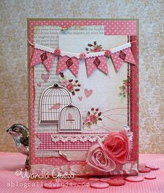 Shabby chic card in pink ... bird cages, banners, beautiful fabric roses and more ...