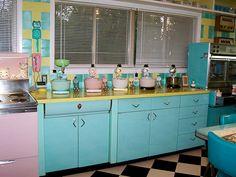 Retro Kitchen and appliances. Love the Aqua Felix Cat Clock on the wall!!