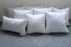 Find feather pillow forms INSIDE PILLOWS! Duh! Get them cheap at thrift stores or Goodwill instead of paying upwards of $20 per pillow form.