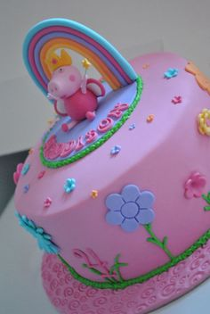 Peppa pig garden rainbow cake with hand made topper