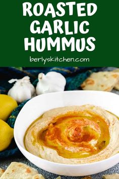 A creamy, savory roasted garlic hummus recipe using canned chickpeas, tahini, and roasted garlic. Make hummus at home with this simple 4-step recipe! #berlyskitchen